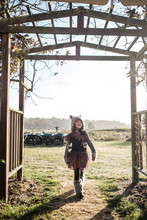 Asian Girl In A Wolf Costume During Fall Season