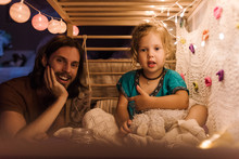 Content Father With Girl Chilling On Bed