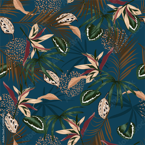 Seamless pattern vector Dark Tropical jungle and colorful palm leaves, exotic palnts with animal skin  floral  design for fashion,fabric,web,wallpaper,and all prints