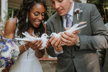 Bride And Groom Holding Doves ...