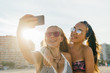 Teen girls having fun at the beach while taking a selfie
