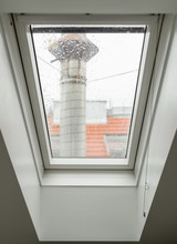 Steamy Window In Mansard Roof With Street View