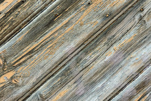 Shabby Weathered Plank Wood Background. Geometrical Graphic Diagonal Pattern Fragment Of Old Gates Door. Gradient Gray Color Hues With Yellow Chipped Paint Inclusions. Rustic Vintage Style. Wallpaper