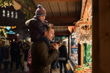 Man With Kid Exploring Stall On Winter Fair