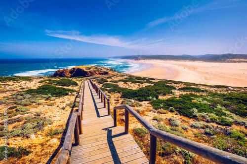 Valokuva  Praia da Bordeira and boardwalks forming part of the trail of tides or Pontal da Carrapateira walk in Portugal