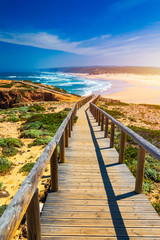 FototapetaPraia da Bordeira and boardwalks forming part of the trail of tides or Pontal da Carrapateira walk in Portugal. Amazing view of the Praia da Bordeira in portuguese. Bordeira, Algarve, Portugal.