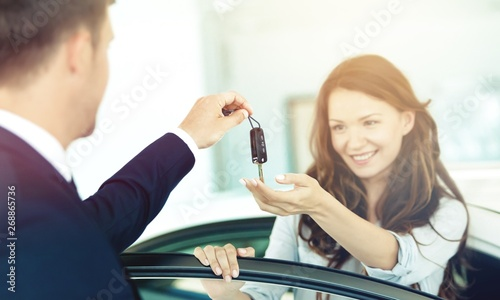 Young beautiful woman taking keys
