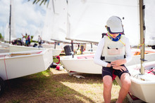 Boy In Sailing Gear Waiting To Launch At A Sailing Regatta