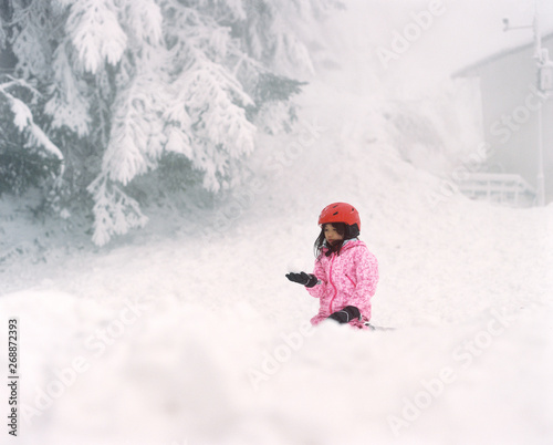 Asian little girl playing quietly in the snow. shot by 120 films