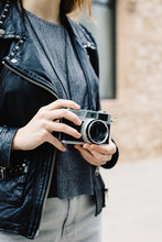 Anonymous Woman In Leather Jacket Holding Photo Camera