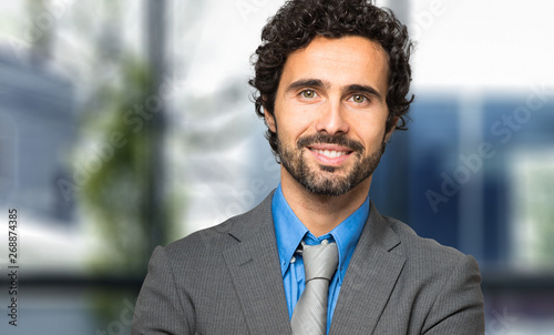 Portrait of a handsome businessman in a modern office