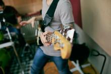 Close Up Of Musician Plays Bass Guitar.