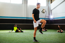 Soccer Player Training In Football Field.