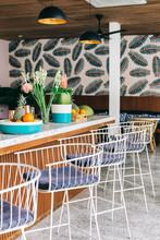Bar Stools In Stylish Tropical Beach Club Bar