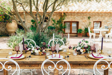 An Outdoor Table Decorated For A Party