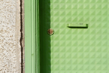 Old and painted green door pattern