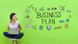 Leinwandbild Motiv Business plan with young woman using a laptop computer