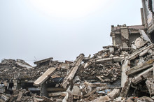 A Huge Pile Of Gray Concrete Debris From Piles And Stones Of The Destroyed Building. The Impact Of The Destruction.