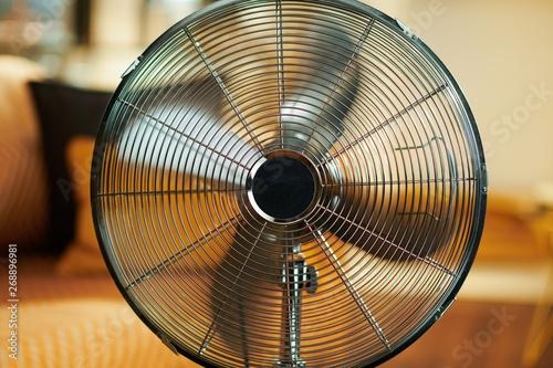 Valokuvatapetti Closeup on working metallic floor standing fan