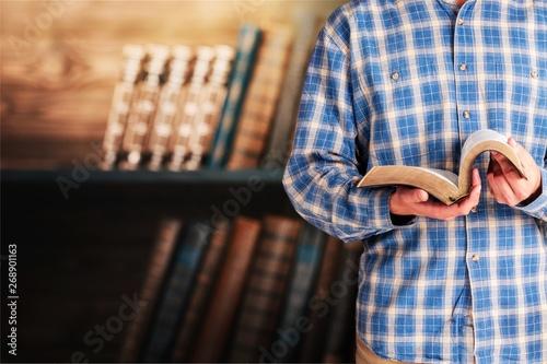 Man reading Bible on  background Wallpaper Mural