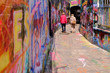 canvas print picture - Couple walking in graffiti street, Ghent, Belgium, Europe