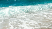 Beautiful Image Of Turquoise Sea Waves Rolling Over The Shore At Bright Sunny Day