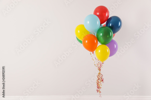 Bunch of bright balloons on light background, space for text Canvas-taulu