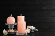 canvas print picture Composition of burning candles, spa stones and flowers on table. Space for text