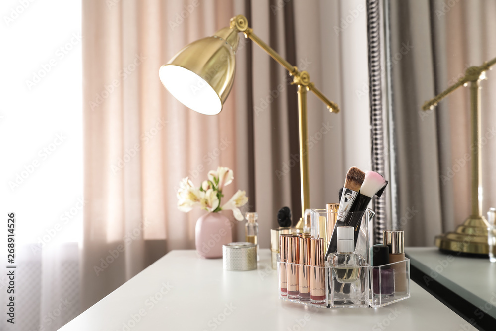 Fototapety, obrazy: Luxury makeup products and accessories on dressing table with mirror. Space for text