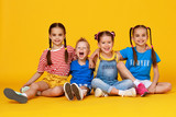 group of cheerful happy children on colored yellow background. - 268917393
