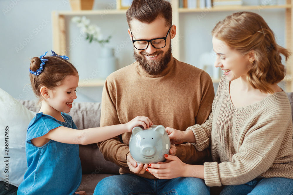 Fototapety, obrazy: family savings, budget planning, children's pocket money. family with piggy Bank  .