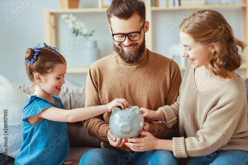 Fototapeta family savings, budget planning, children's pocket money. family with piggy Bank  . obraz