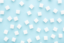 Abstract Pattern Made Of Sugar Cubes Scattered On Blue Background