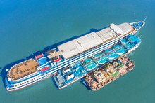 Refueling At Sea - Small Oil Products Ship Fuelling A Large Bulk Carrier, Aerial Image.