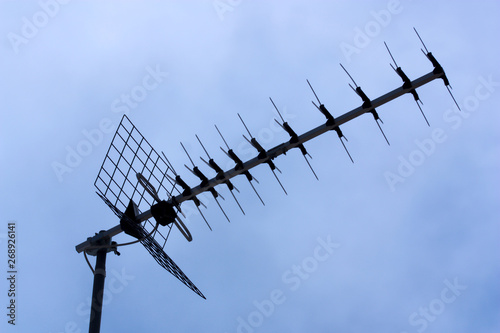 Canvas Print Domestic television antenna on a roof
