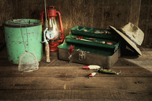 Vintage Fishing Equipment And Lantern On Grungy Wood Surface