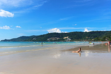 Phuket Province, Thailand - November17, 2017: Nai Harn Beach. Beautiful beach and sea in Phuket, Thailand. Traveller from around the world come to relax in the summer holidays.