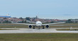 Airplane taxiing on runway of the airport