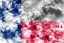 The National Flag Of The US State Texas In Against A Gray Smoke On The Day Of Independence In Different Colors Of Blue Red And Yellow. Political And Religious Disputes, Customs And Delivery.
