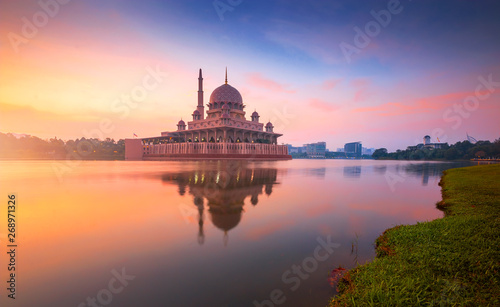 Floating mosque during sunrise. Putra Mosque, Putrajaya, Malaysia.