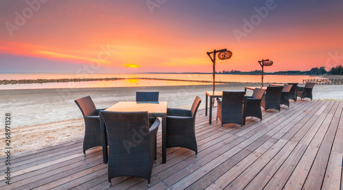 Keuken foto achterwand Lavendel Restaurant on a beach with Stunning beautiful sunset.