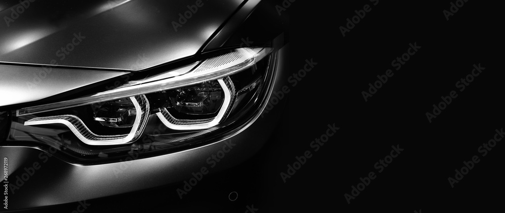 Fototapety, obrazy: Detail on one of the LED headlights modern car on black background
