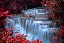 Long Exposure Waterfall In The Park And Change The Leaves Color Over Red