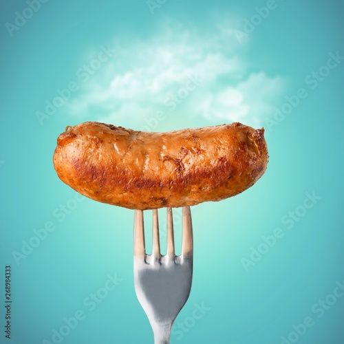Foto Freshly cooked sausage on a fork