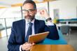 Confident senior businessman leader working in office