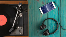 Listen Online Radio Concept - Online Music Player App On Smartphone With Vintage Turntable And Headphones