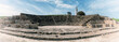 Leinwanddruck Bild - Ancient Odeon amphitheatre in Paphos Archaeological Park (Kato Pafos), harbour of Paphos, Cyprus, panoramic view. Scenic landscape with ruin of medieval architecture, lighthouse and sky, vintage image