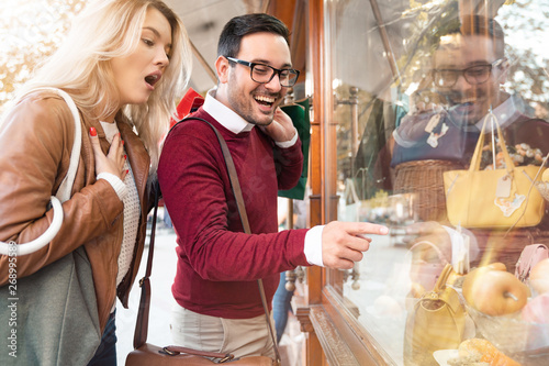 Foto op Plexiglas Bakkerij Shopping time. Young couple in shopping. Consumerism, love, dating, lifestyle concept - Stock Image