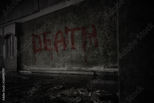 Fototapeta  text death on the dirty wall in an abandoned ruined house
