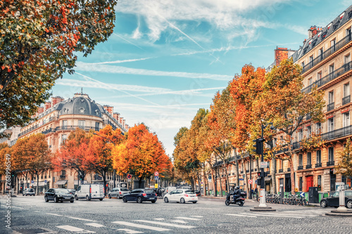Aluminium Prints Autumn Streets of Paris, France. Blue sky, buildings and traffic.